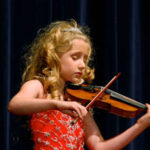 Violin Prodigy Helps Rebuild Haitian School